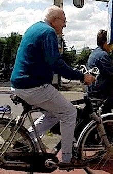 Elderly man cycling in the Netherlands