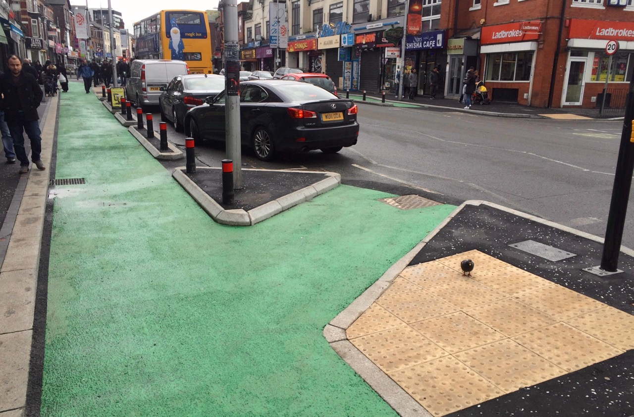 Pedestrians in the protected cycle lane