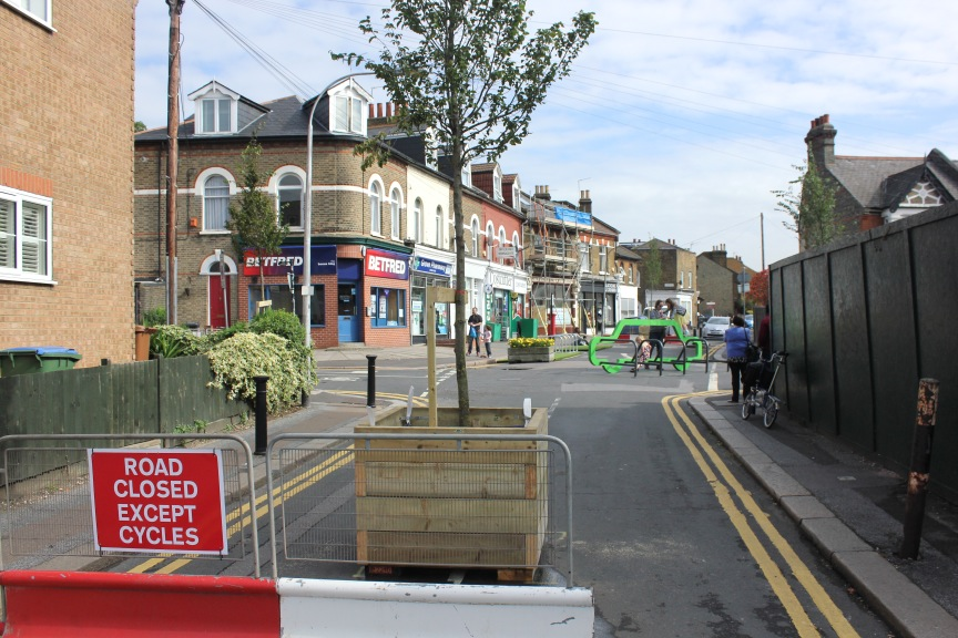 Road closed with a planter, creating filtered permeability