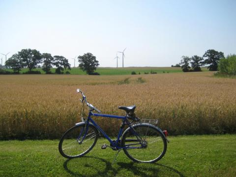 Bicycle with wind turbines behind