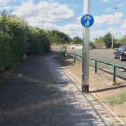 Paved footpath next to junction with Aston Church Road