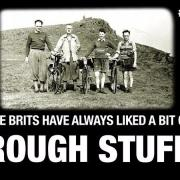 Old photo of British cycle riders on a mountain top.