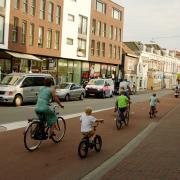 A family cycling out of the centre of Dordrecht.