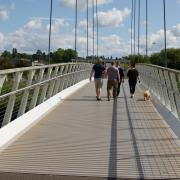 A family and their dog crossing Diglis Bridge