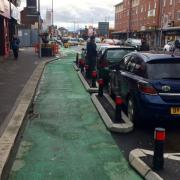 A cycle lane protected by car parking spaces