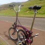 Buster the Brompton below Arthur's Seat