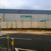 A huge wall prevents people from walking the short distance from Sainsbury's to Poundland