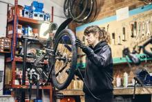 Marta working on a bike