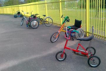 A selection of adapted cycles, with a Raleigh Chopper style tricycle in the foreground