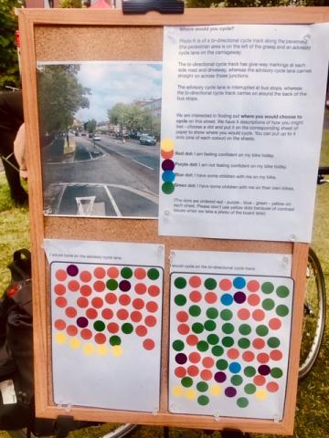 This photo shows the setup of the board that we used to ask people's opinions about the photo of the two types of cycle infrastructure.